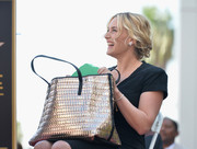 Kate Winslet attended her Hollywood Walk of Fame ceremony carrying a chic oversized gold tote.