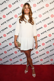 Kelly Bensimon showed off her long legs with this mod-inspired white frock.