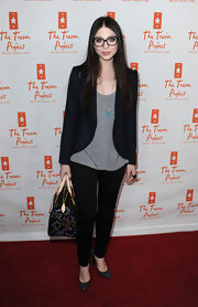 Michelle Trachtenberg paired her geek chic look with gray patent pumps.