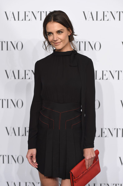 Katie Holmes Leather Clutch [clothing,little black dress,dress,fashion,shoulder,hairstyle,cocktail dress,joint,footwear,formal wear,arrivals,valentino sala bianca 945,katie holmes,new york city,event]