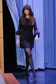 Katie Holmes made an appearance on 'Jimmy Fallon' looking cute in a Saint Laurent LBD with a bowed neckline and ruffle cuffs.
