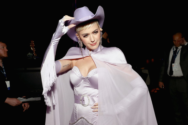 Katy Perry Cowboy Hat [musicares person of the year,dolly parton,katy perry,white,fashion,beauty,skin,lady,human,fun,headgear,event,formal wear,los angeles convention center,california]