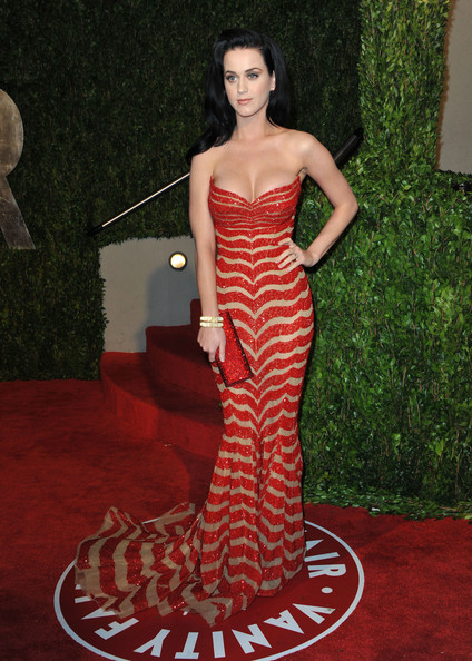 Katy Perry Strapless Dress [oscar party,vanity fair,flooring,carpet,dress,fashion model,gown,red carpet,shoulder,fashion,haute couture,photo shoot,west hollywood,california,sunset tower,katy perry,graydon carter - arrivals,graydon carter]