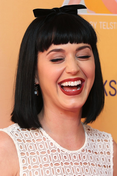 Katy Perry Hair Bow [hair,face,hairstyle,eyebrow,facial expression,chin,lip,smile,bangs,forehead,katy perry,media call,joke,media,george street,sydney,australia,telstra hq]