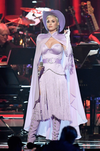 Katy Perry Cape [performance,fashion,clothing,fashion model,lady,beauty,hairstyle,event,public event,dress,musicares person of the year,dolly parton - show,los angeles convention center,california,dolly parton,katy perry]