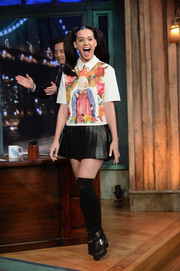 Katy Perry looked like a schoolgirl on 'Late Night with Jimmy Fallon' in a pleated black mini and knee-high socks.