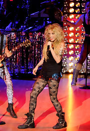 Kesha wears floral fishnets for her performance in Madrid.