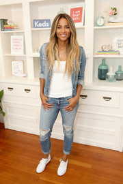 Ciara kept it super casual in a denim jacket layered over a white top while attending a Keds event.