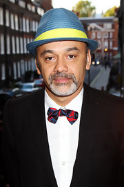 Christian Lououtin paired his colorful fedora hat with a red and blue bowtie.