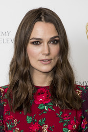 Keira Knightley played up her eyes with smoky brown shadow.