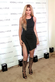 Kylie Jenner amped up her outfit with black lace-up heels at the launch of her Kendall + Kylie collection.