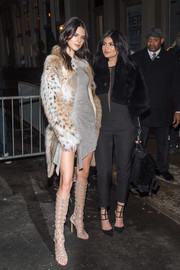 Kylie Jenner pulled her outfit together with a pair of strappy black pumps, also by Kendall + Kylie.