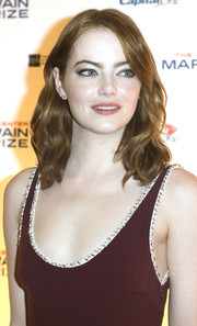 Emma Stone attended the Mark Twain Prize event wearing her signature shoulder-length waves.