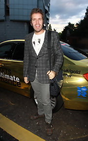 Perez Hilton was in the mood for plaid, wearing a gray tweed jacket with print sneaks to the Kensington Nightclub launch.