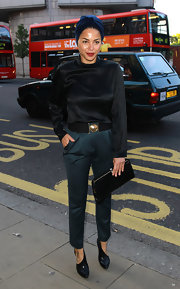 Ana Araujo paired teal slacks with her black blouse for the launch of the Kensington Club.