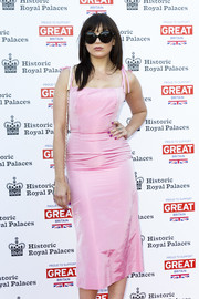 Daisy Lowe posed on the Kensington Palace Summer Gala red carpet wearing a pair of oversized black shades.