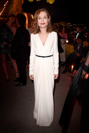 Isabelle Huppert kept it classic in a long-sleeve, V-neck column dress by Saint Laurent at the Kering and Cannes Women in Motion dinner.