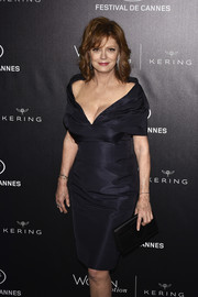 Susan Sarandon showed some cleavage in a low-cut off-the-shoulder LBD at the Kering and Cannes Festival official dinner.