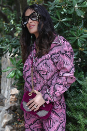 Salma Hayek accessorized with a purple Gucci chain-strap bag and a pair of statement shades at the Kering Women in Motion lunch.