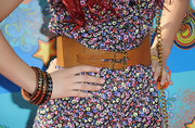 Ariana Grande paired her floral dress with studded wood bangles.
