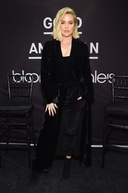 Khloe Kardashian covered up in an elegant black velvet coat by Unravel for the launch of Good American at Bloomingdale's.