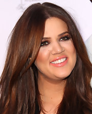 Khloe Kardashian looked ready for the spring season with petal pink lipstick. The soft color was a great way to offset her bronzed lids.