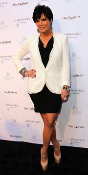 Kris Jenner teamed her black-and-white launch look with tan leather Lady Daf platform pumps.