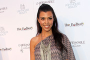 Kourtney Kardashian poses for photographers during the