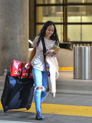Karrueche Tran kept it super laid-back in a plain beige tee while catching a flight out of LAX.