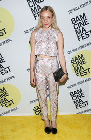Chloe Sevigny completed her ensemble with a quilted black clutch by Miu Miu.
