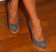 Stephanie Pratt chose gray and wooded platform pumps for her look at a charity event in Santa Monica.
