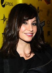 Gina Gershon attended the premiere of 'Killer Joe' wearing her hair in a shiny layers with long side-swept bangs.