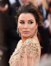 Eva Longoria was sexily coiffed with this mussed-up, loose ponytail at the Cannes Film Festival premiere of 'The Killing of a Sacred Deer.'