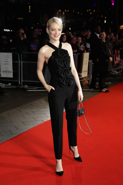 Emma Stone complemented her jumpsuit with black cap-toe pumps.