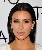 Kim Kardashian opted for a simple center-parted hairstyle when she celebrated her birthday.