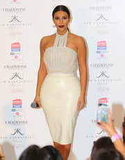 Kim Kardashian sheathed her famous hips in a cream-colored latex pencil skirt by Atsuko Kudo.