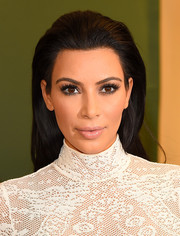 Kim Kardashian finished off her look with a glossy nude pout.