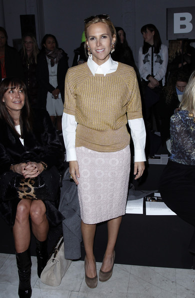 Tory Burch stayed true to her classic style with a light pink printed skirt.