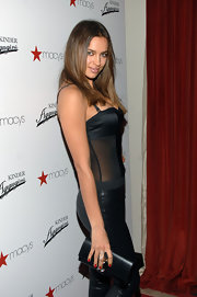 Irina Shayk added a classic touch to her look with radiant red nail polish.