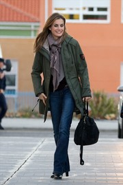 Princess Letizia toughened up in a bulky military jacket while visiting King Juan Carlos in the hospital.
