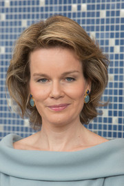 Queen Mathilde of Belgium sported a teased bob while visiting SHAPE.