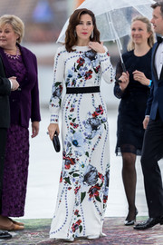 Princess Marie looked lovely in a floral gown at the celebration of King Harald and Queen Sonja of Norway's 80th birthdays.