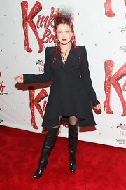 Cyndi Lauper chose this fitted evening coat with a full skirt for her punk-inspired red carpet look.