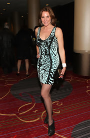 LuAnn de Lesseps showed he wild side with this turquoise animal-print dress.