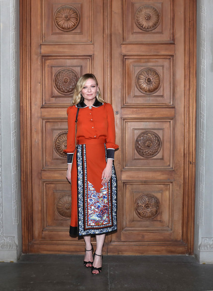 Kirsten Dunst Button Down Shirt [clothing,fashion,standing,pattern,outerwear,dress,door,neck,fashion design,cruise 2018 - arrivals,kirsten dunst,palazzo pitti,florence,italy,gucci,fashion show,gucci cruise 2018]