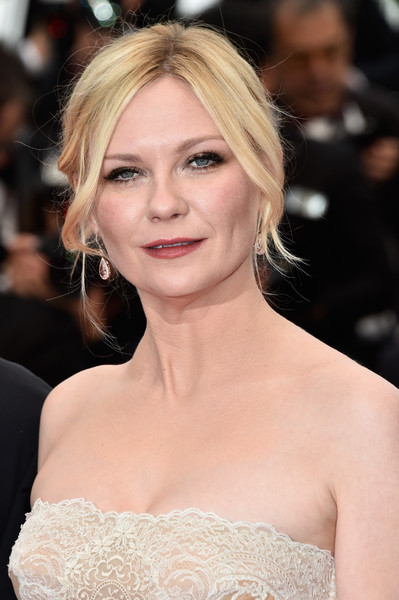 Kirsten Dunst Loose Bun [hair,face,hairstyle,eyebrow,blond,lip,skin,beauty,shoulder,chin,red carpet arrivals,kirsten dunst,cannes,france,palais des festivals,closing ceremony,cannes film festival,closing ceremony]