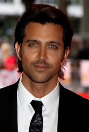 Hrithik wears his hair uniquely layered and slightly tinted red.