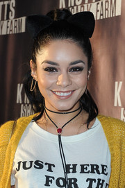 Vanessa Hudgens topped off her playful look with a cat ear headband.