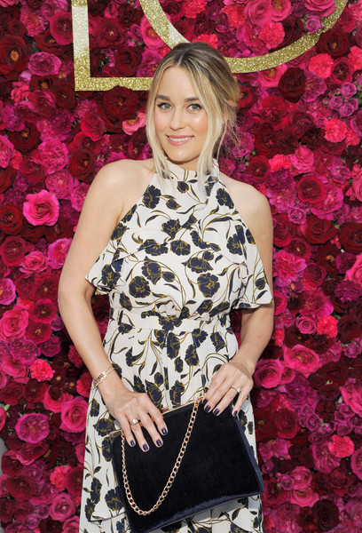 Lauren Conrad showed off an elegant chain-strap velvet bag from her own line during the Girls' Night Out party.