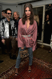 Emily Ratajkowski rocked mixed prints with this leopard purse and patterned jacket combo.